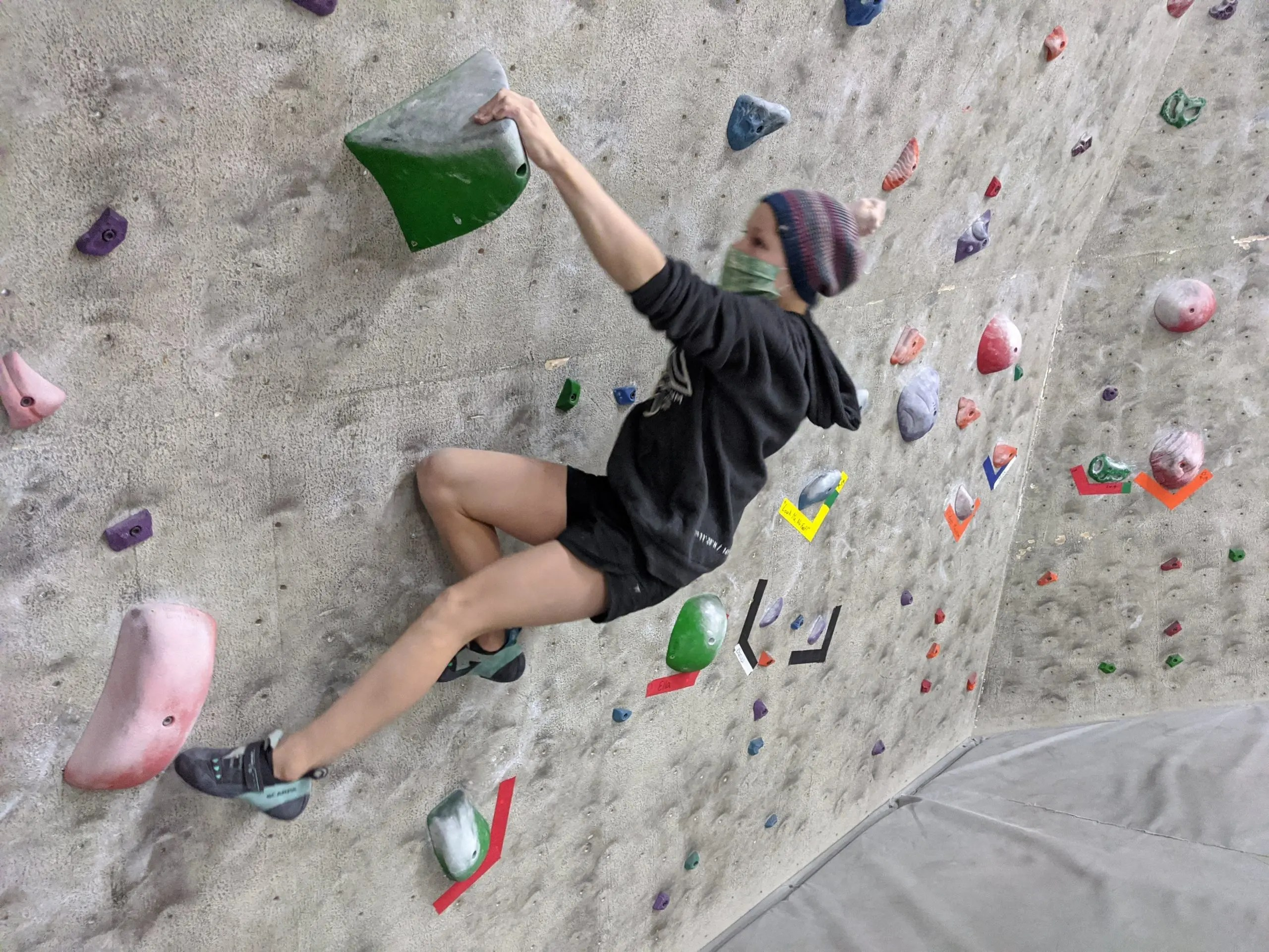 climber on the wave wall at ascension rock club