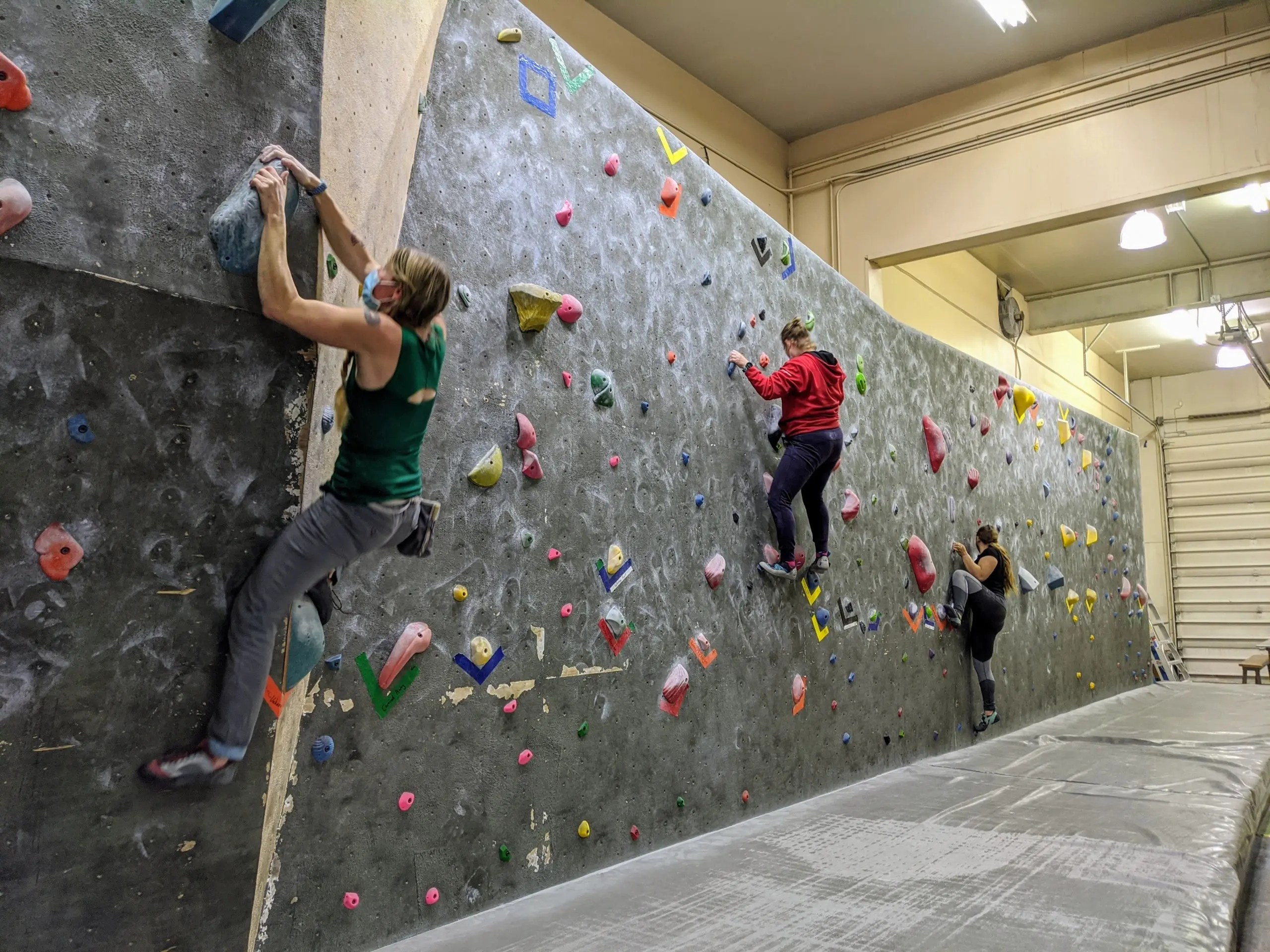 three climbers climbing on the vertical wall at ascension rock club