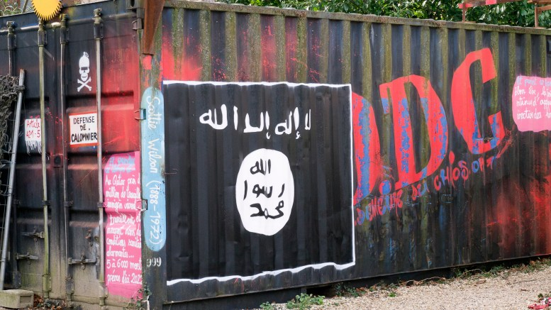 Graffiti of the ISIS flag sprawled on a shipping container