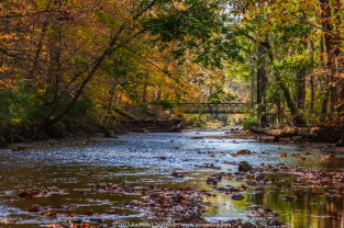 Looking down stream at the bridge crossing the East Branch of the White Clay Creek in Chester County PA.