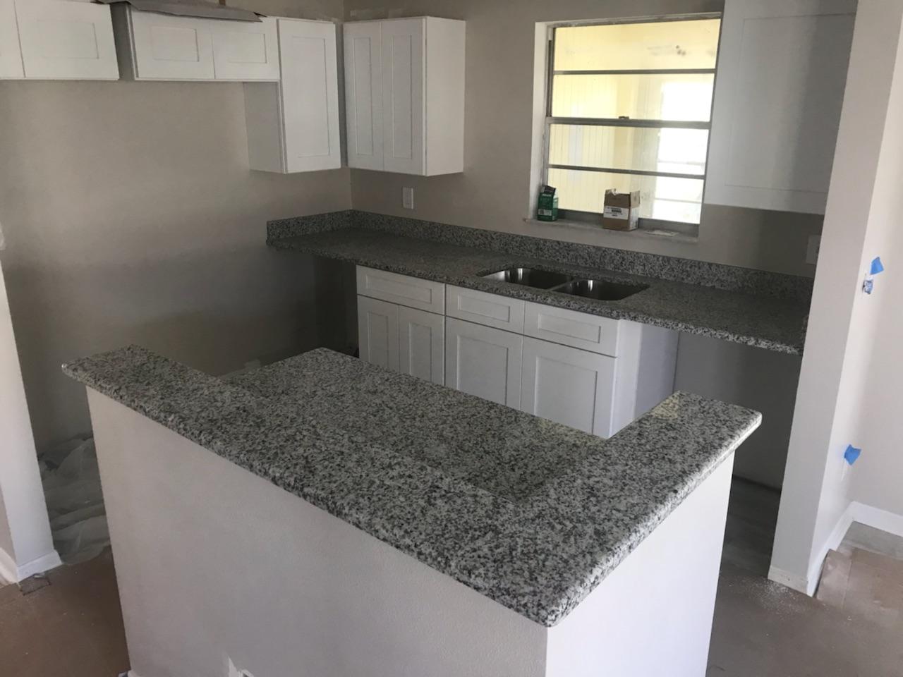 Salt and Pepper grey white granite kitchen countertop slabs in Lutz ...