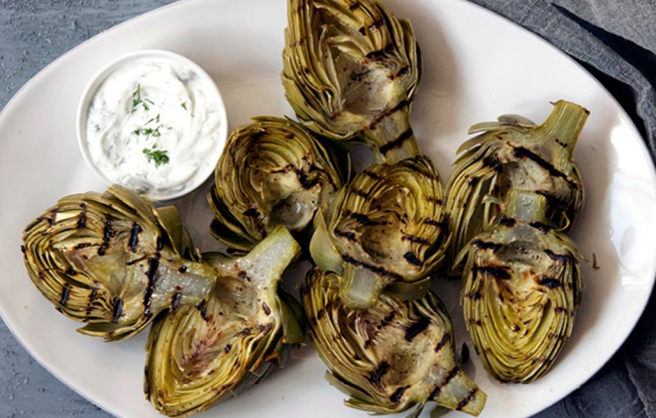 Grilled green artichokes