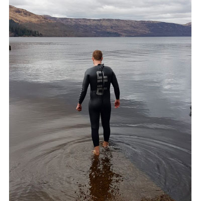 wild swimming in a wet suit