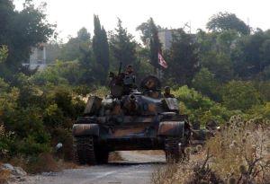 543494-un-char-de-l-armee-syrienne-positionne-dans-la-region-de-lattaquie-sur-une-photo-de-l-agence-syrienn