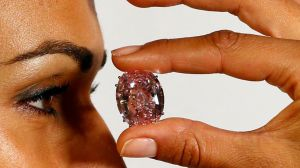 File photo of model displaying 'Pink Star' 59.60 carat oval cut pink diamond at Sotheby's in Geneva