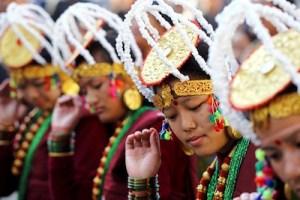 Gurung girls wearing traditional dress and dancing in tamu looser