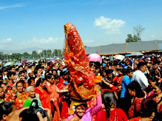 A woman carrying Gaura Devi on her head during a function organised to mark Gaura Parva in Tundikhel, Kathmandu.