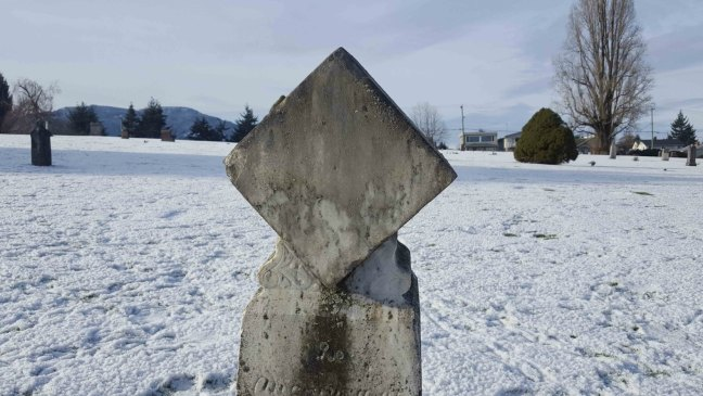 The defaced Joseph Foy garvestone in Bowen Road Cemetery, 14 January 2017, Note how someone has covered the Square and Compasses with cement on the diamond shaped stone on top of the marker.