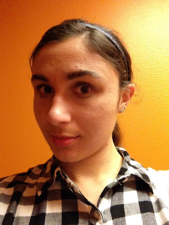 Ashlee Craft wearing a black & white plaid shirt & sparkly headband