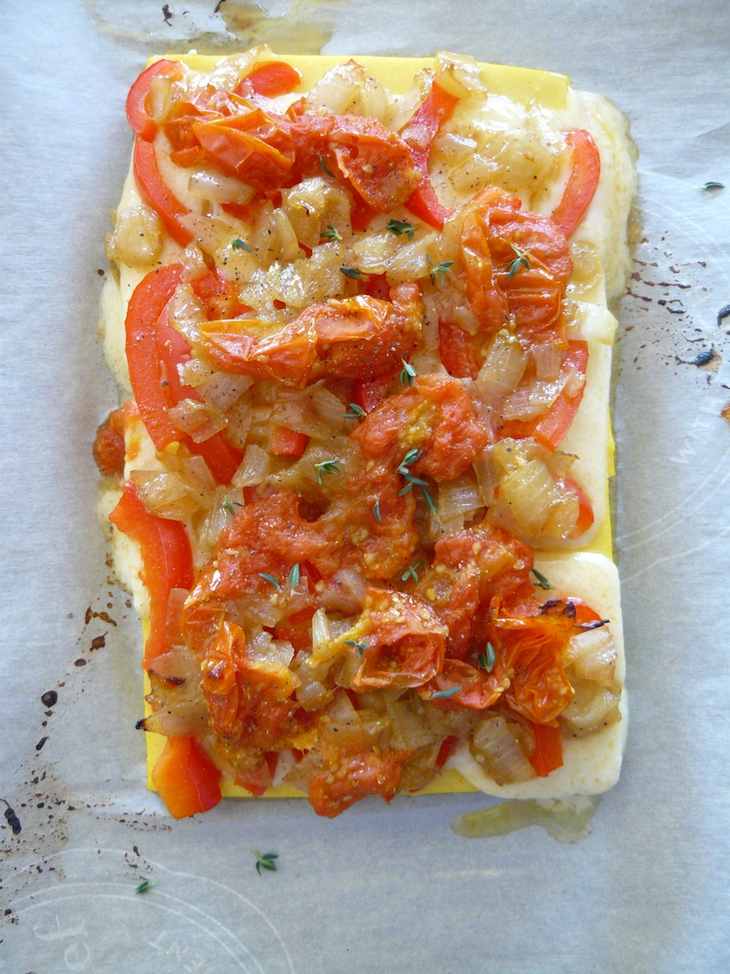 Chickpea tofu pizza with roasted tomatoes, fresh thyme, red pepper and caramellized onions