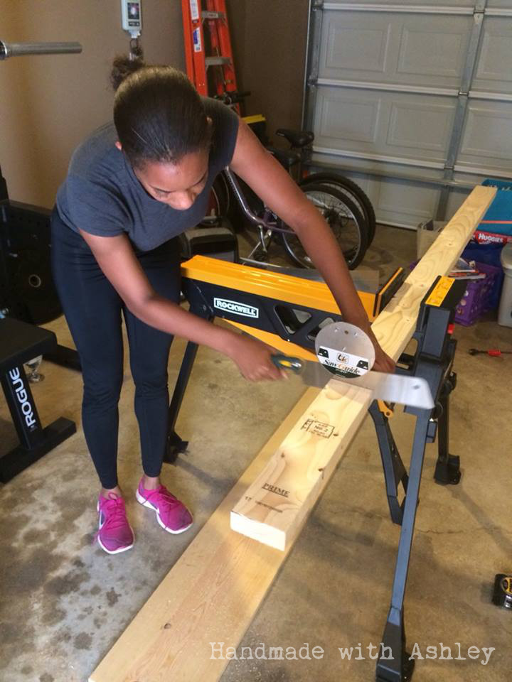 My sister cutting boards with a Japanese handsaw