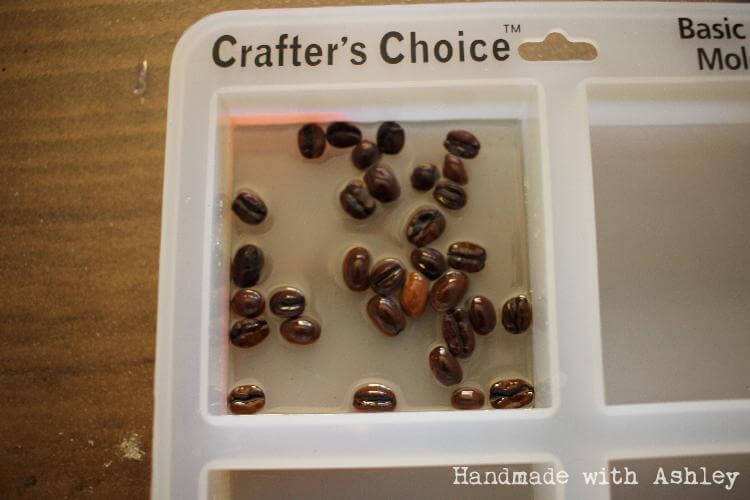 Pour a layer of resin with the whole coffee beans