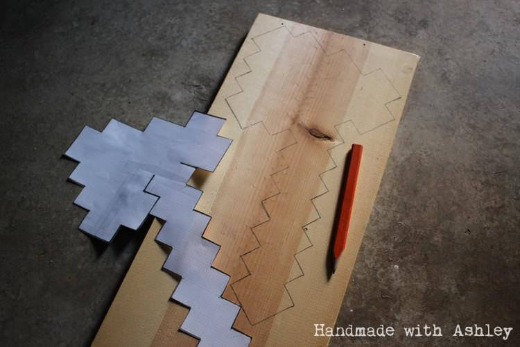 Tracing pattern onto scrap piece of lumber