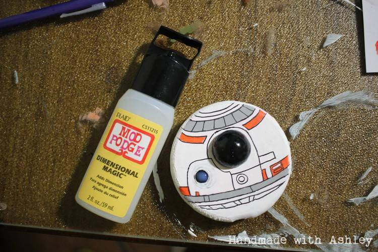 "Adding Mod Podge Dimensional Magic to one of BB-8's ""eyes"""