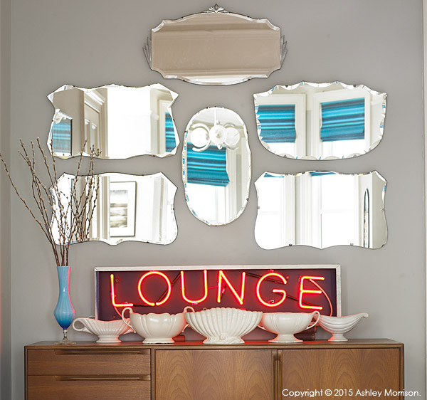 Display of mirrors and Lounge sign in the sitting room of Keri Johnston'stownhouse.