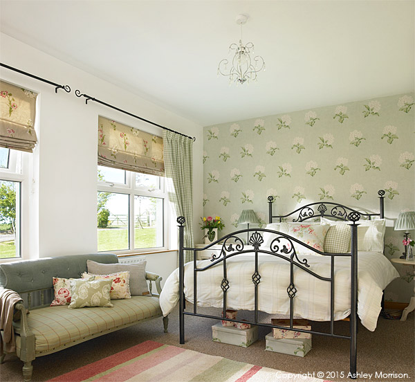 The bedroom in Lesley & Lindsay Anderson's cottage style bungalow.