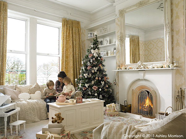 Amanda Cunningham her children in the sitting room of their double fronted mid terrace house in Belfast at Christmas.