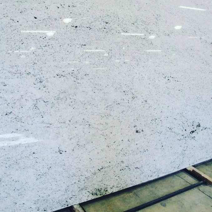 I paired this #hymalayan white #granite with #kraftmaid midnight blue cabinets in our Atlanta condo. #condokitchen #galleykitchen #stonecountertops #buckheadatlanta #granitecountertops #Atlanta ❤️❤️