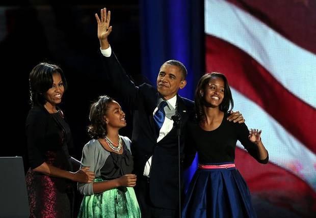 Il Presidente degli Stati Uniti Barack Obama con la moglie e le figlie.