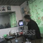 In North Korea, the portraits of Kim Il-sung and Kim Jong-il are hung in every household, worksite and public place. This photo was taken in the living room of an ordinary family. Adding to the portraits of Kim Il-sung and Kim Jong-il, Kim Jong-suk (Kim Jong-Il's mother) is also hung high on the wall. (April. 2007. Taken by Lee Jun)  ASIAPRESS