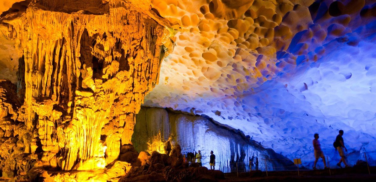 lit up interior of large halong bay cave