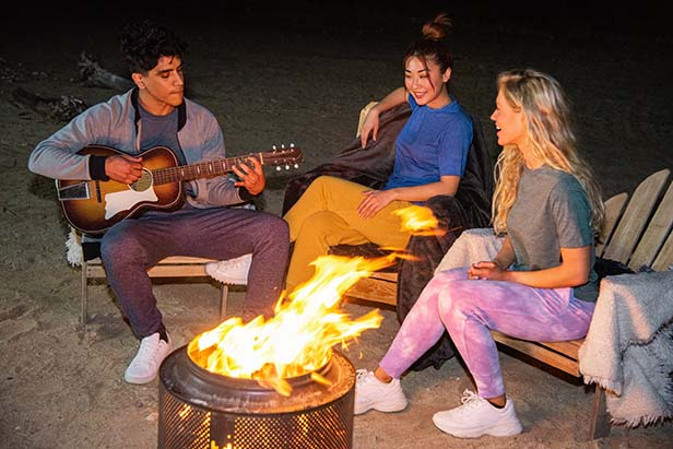 Young people around a camp fire