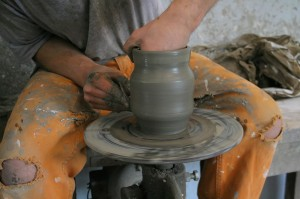 Person Making Pottery