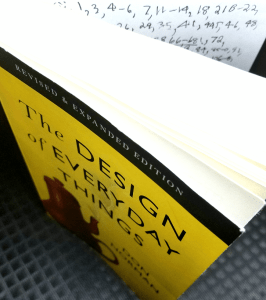 "My copy of ""The Design of Everyday Things"" with the inside back cover used to note down impactful pages."