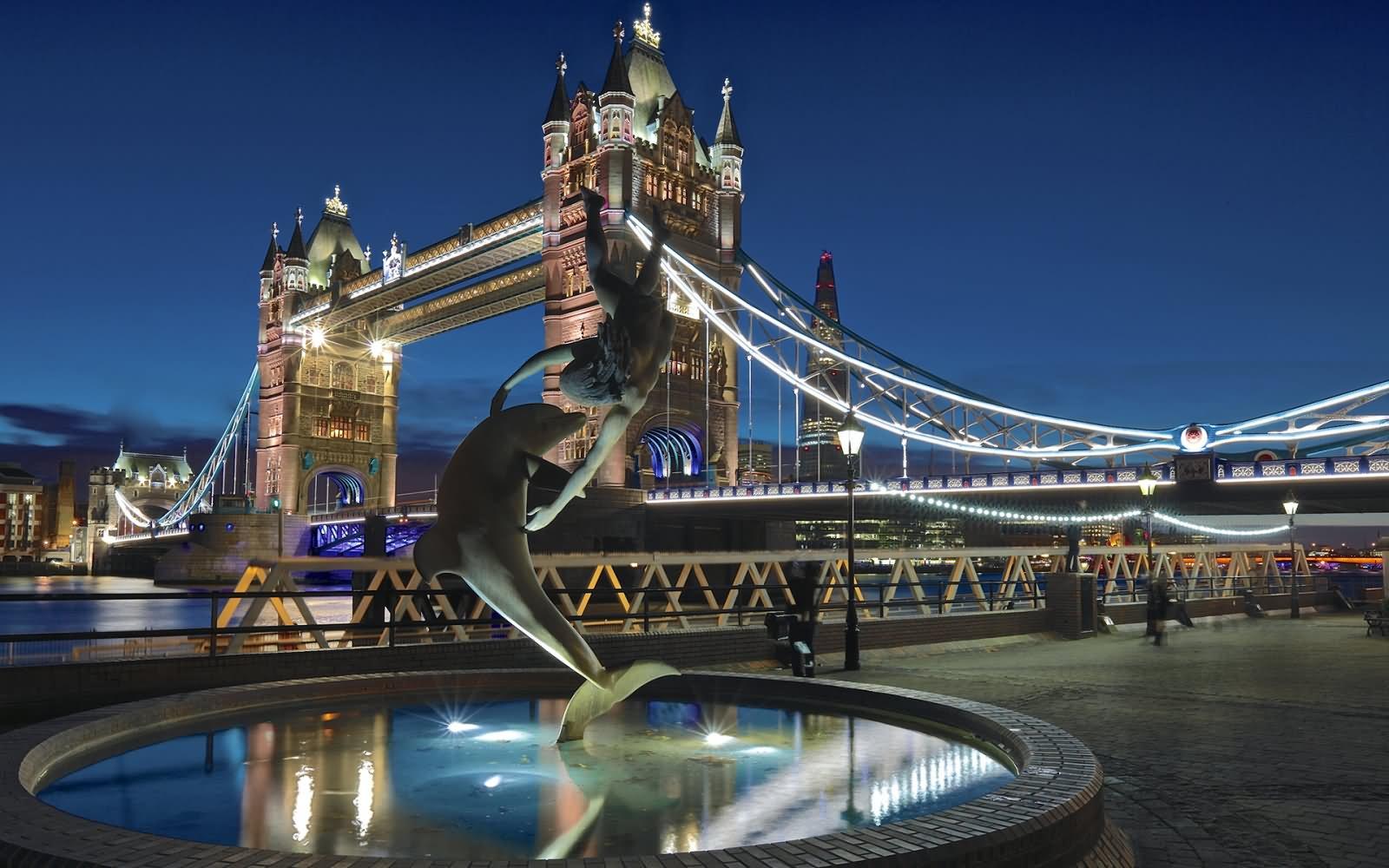 Dolphin Fountain Near Tower Bridge At Night