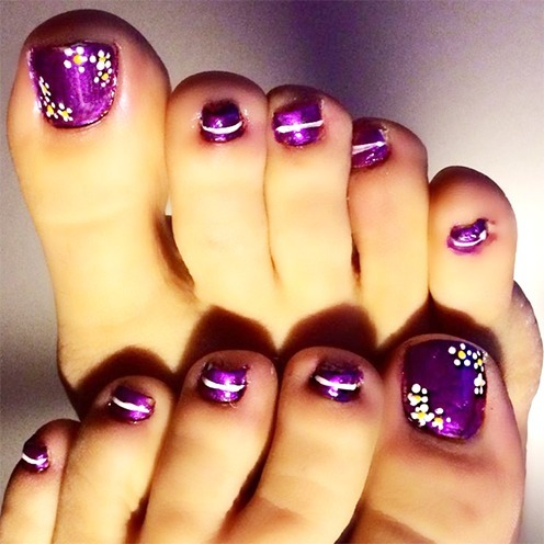 Colorful Tribal Inspired Toenail Art Design The Nails Are Painted With Matte White And Orange