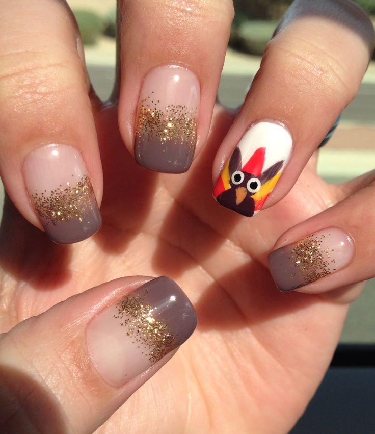 Brown And Gold Glitter Nails With Accent Turkey Face Thanksgiving Nail Art