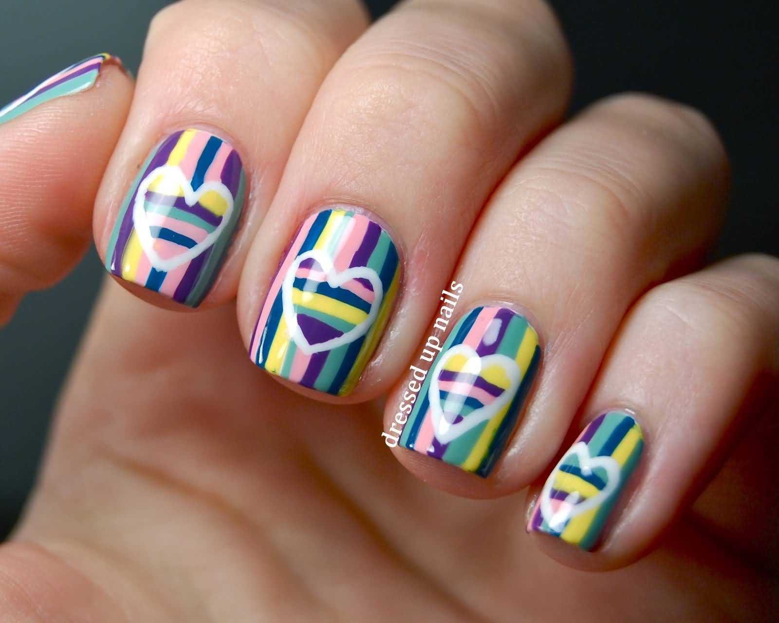 Multicolored Stripes Nail Art With White Heart Design