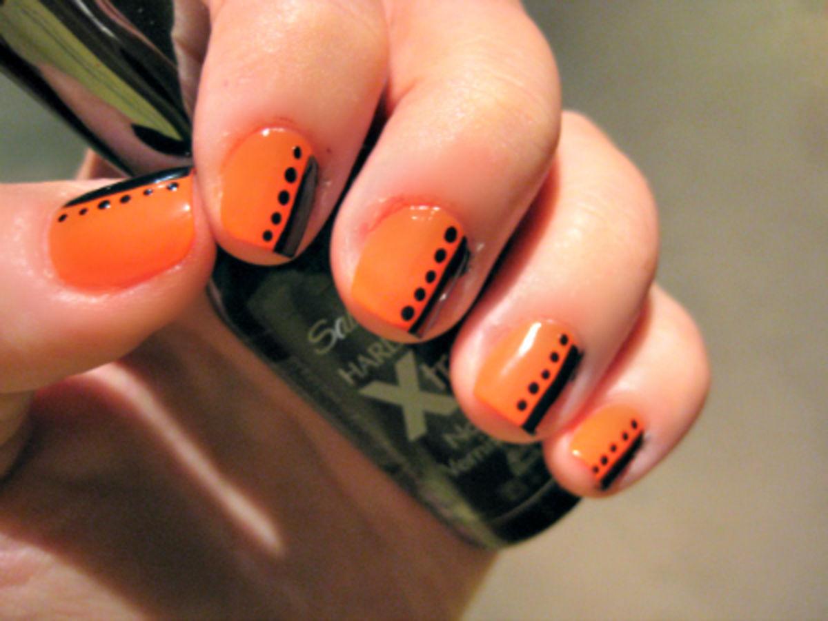 Orange Nails With Black Strip And Dots Design Nail Art