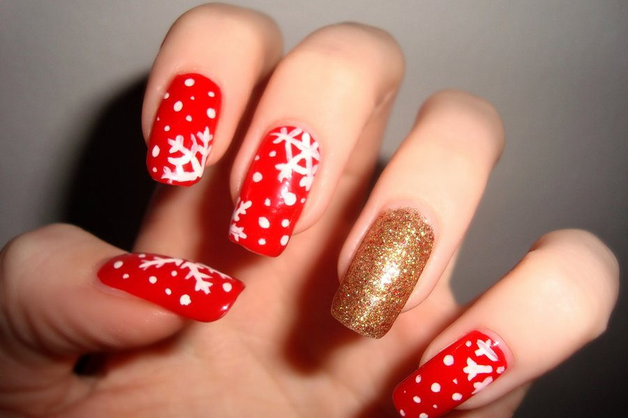 Red Nails With White Snowflakes Christmas Nail Art