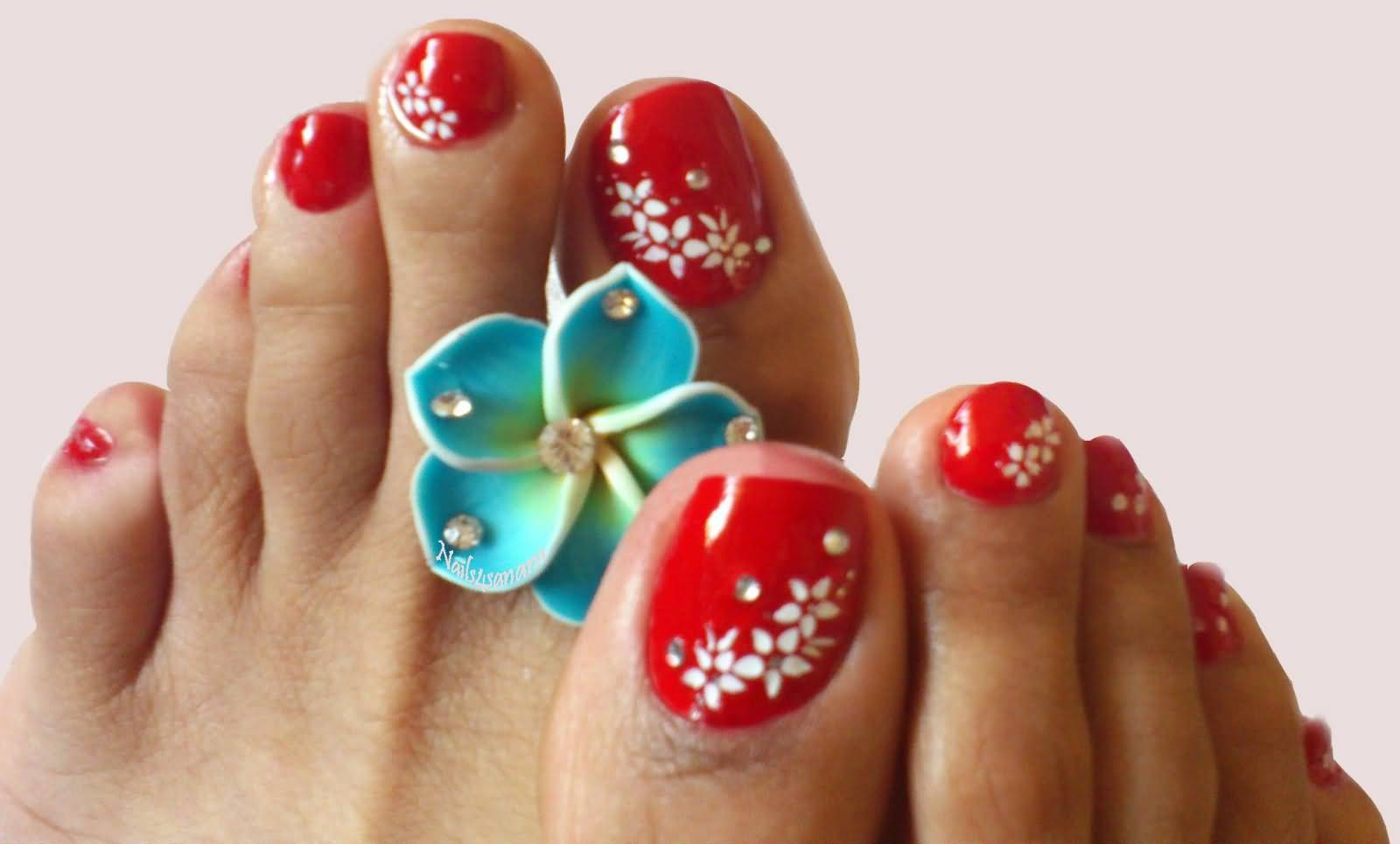 Red Toe Nails With White Flowers Nail Art