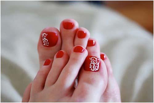 Red Toe Nails With White Swirls Design Idea