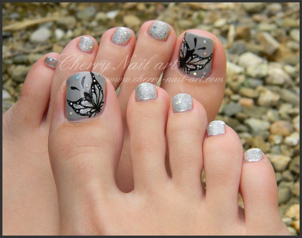 Gray Toe Nails With Black Erfly Design Nail Art