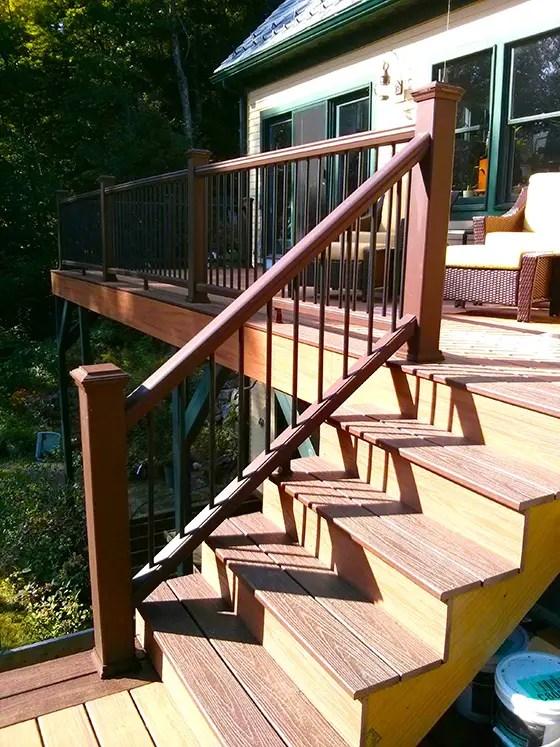 How To Deck Stair Railing   Wood Deck Stair Railing   Step   4X4 Deck   Interior   Underneath Bracket   Gray Deck Black