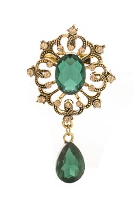 golden vintage brooch with emeralds