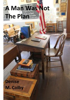 Sample book cover with one-room schoolhouse teacher desk on it by Denise M. Colby