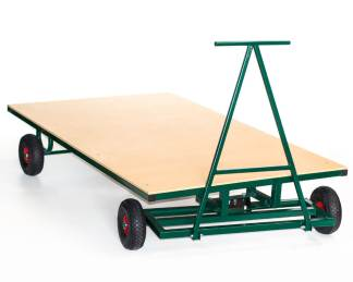 Flat wooden based trolley on heavy duty inflatable wheels, with a steel arm for pulling and turning the trolley. Made to hold large and heavy gymnastic mats, pictured in green