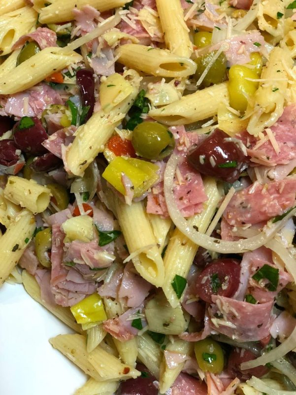 italian pasta salad with cheese and meat and homemade dressing and olives