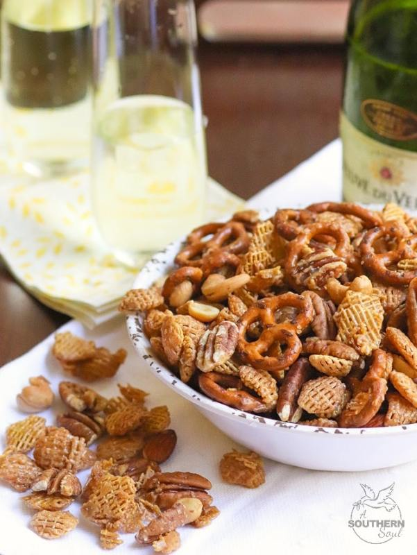 Sweet and Nutty Snack Mix made with brown sugar, butter and corn syrup, them baked until golden brown is a snack that's totally irresistible!