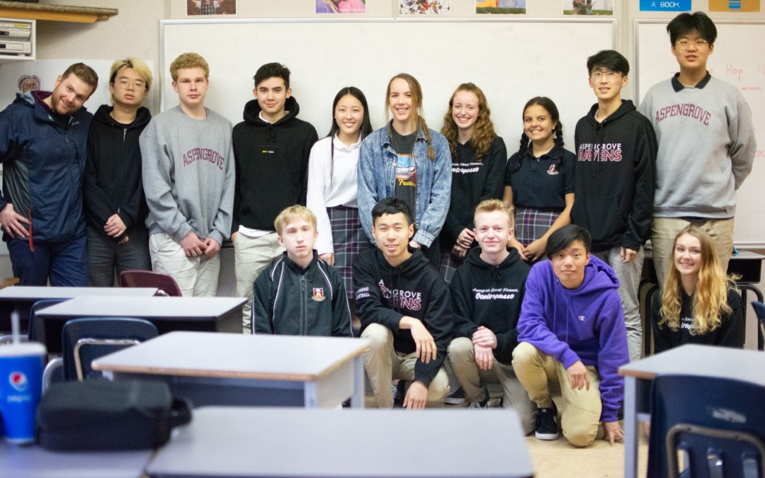 Young alumnus visits with grade 10 class sharing university advice