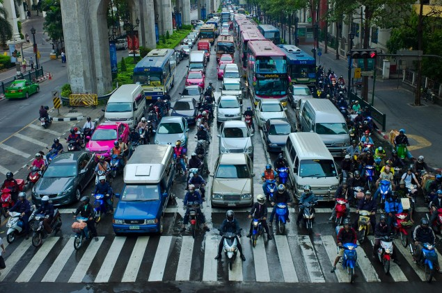 motorcycle-lane-splitting-bangkok-thailand