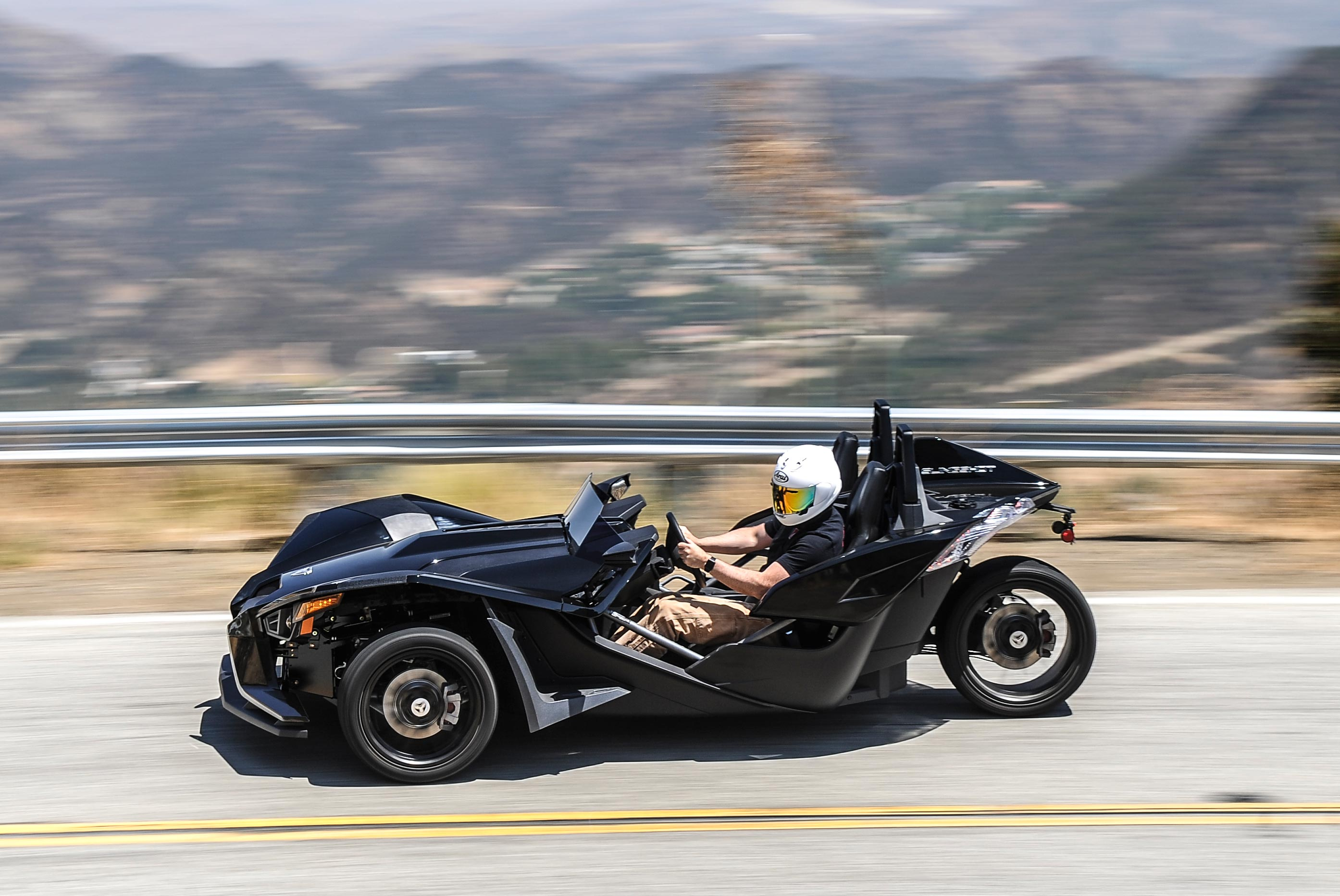 what it 39 s like to drive a motorcycle a review of the polaris slingshot asphalt rubber. Black Bedroom Furniture Sets. Home Design Ideas