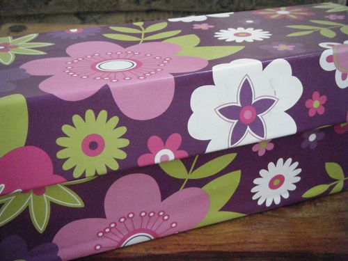 Large box DIY covered in wrapping paper with flowers on it