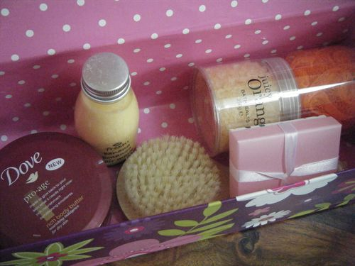 Wrapped DIY box with beauty gifts inside - pink spotty paper lining the beauty hamper box
