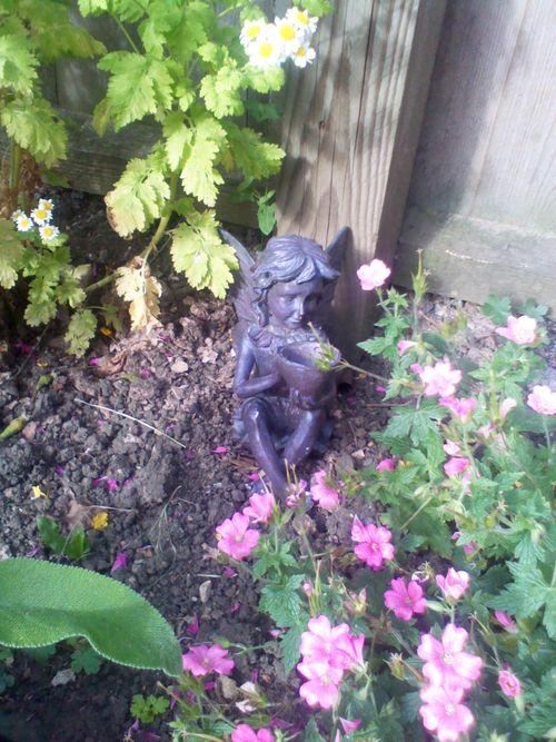 A fairy statue in a garden