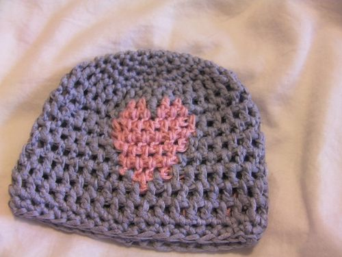 First attempt at a crochet hat with a heart in the design